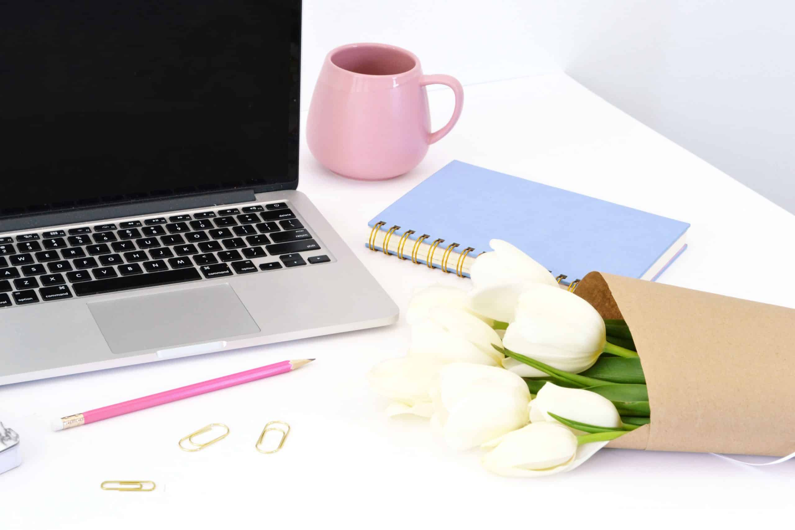laptop on desk, how many blog posts you should have before launching a blog