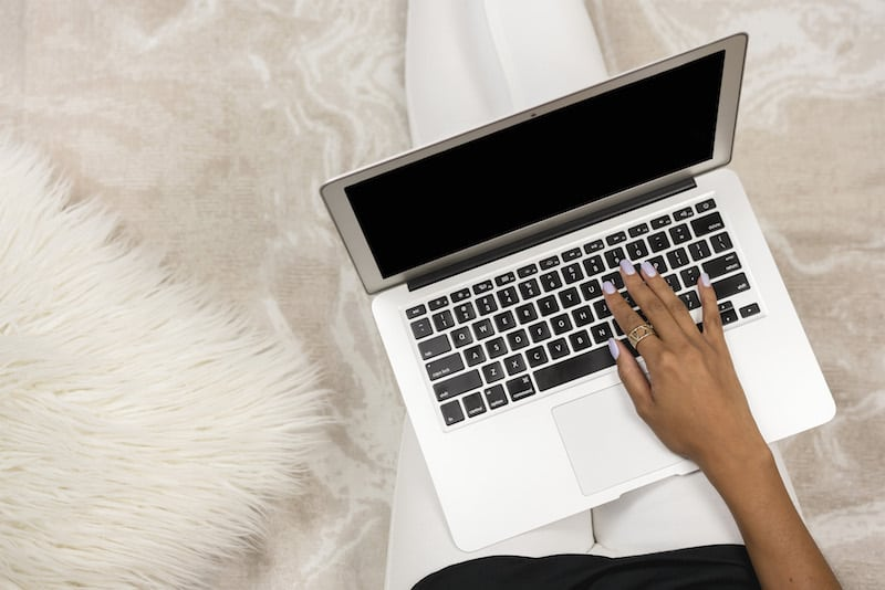 women working from home with her laptop for blogging
