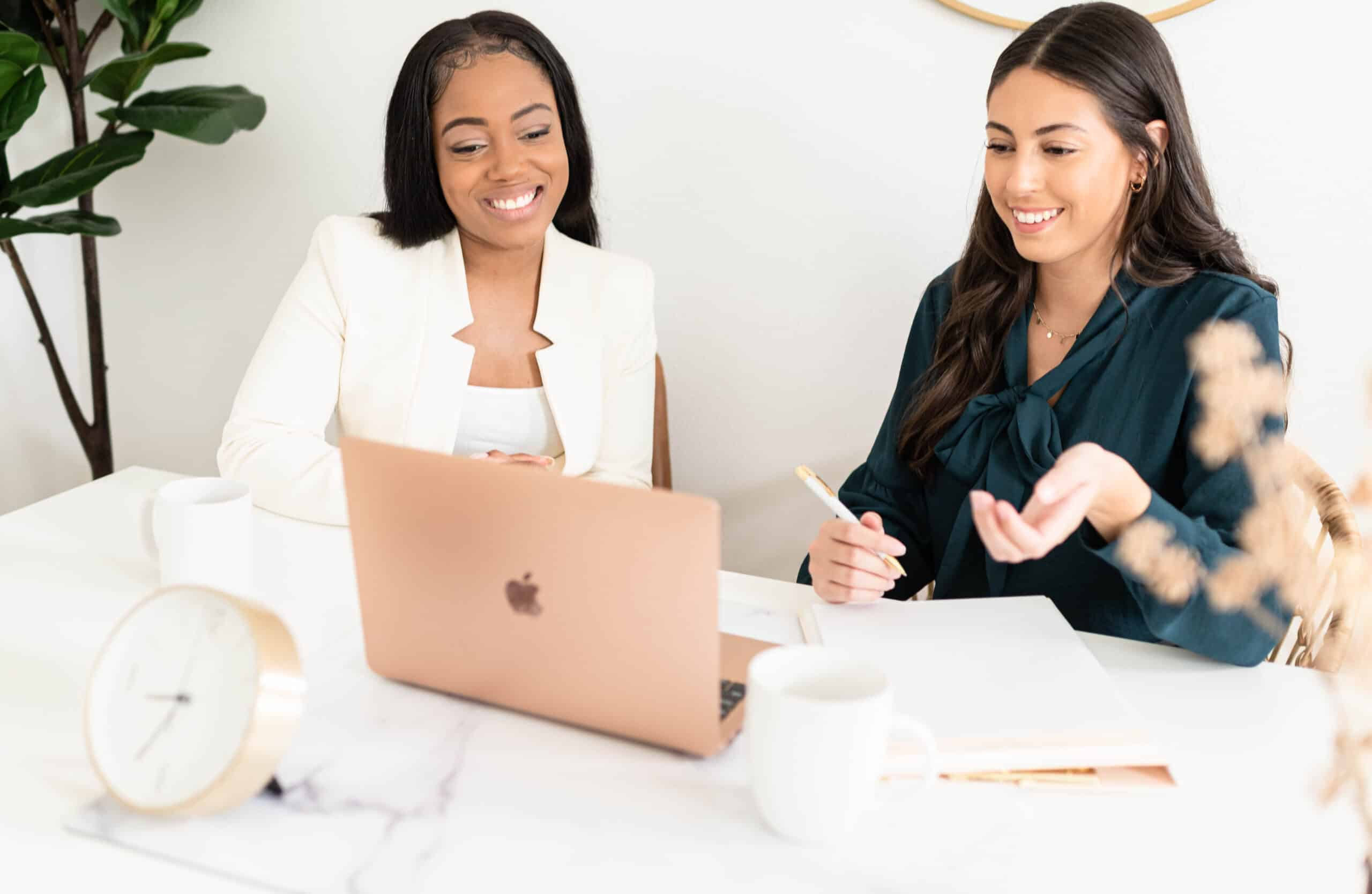 Women discussing business, business name ideas.